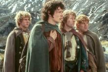 Merry, Frodo, Pippin, and Sam looking off into the distance.