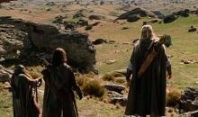 Legolas, Aragorn, and Gimli look over the land.