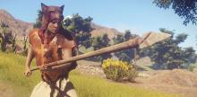 A player, donned in a hide poncho and wold helmet, grips his spear.