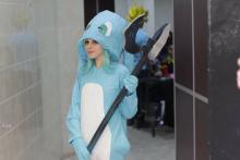 A female fan shows off her fun costume of a champion