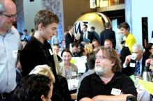 Gabe Newell gives advice to a young gamer in Seattle.