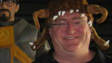 Gabe Newell wearing a Half Life headcrab hat.
