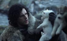 Jon Snow meets his wolf, Ghost. He won't be this cute for long.