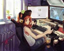 A beautiful young lady, loving her own world of gaming in her own technically suited up, gaming unit!