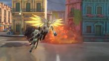 A screenshot of Mercy flying Genji into battle in the Overwatch 2 announcement cinematic.