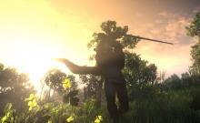Geralt in action in a cloak.