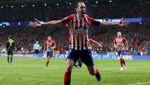 Diego Godín scores a goal for Atlético Madrid and celebrates
