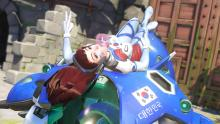 D.va chewing gum while lounging on her meka.
