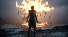 Senua watches a tree burning with many bodies seemed to be hung from it