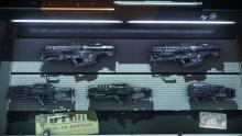 Every weapon store will greet you with a wall full of weapons to choose from.