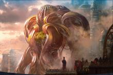A gear hulk towering over a city in Kaladesh
