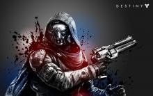A kitted out Hunter stares off screen, wielding a menacing black hand cannon