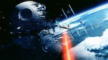 Millennium Falcon escapes TIE fighters next to the Second Death Star.