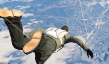 It's a man, It's a plane no its just a guy skydiving
