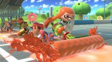 Inkling uses her roller to paint her enemies