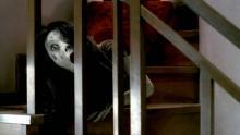 Kayako crawls down the stairs