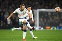 Harry Kane shoots to score a goal for Tottenham