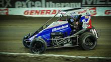 Driver Kyle Larson representing iRacing in a real midget race.