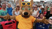 The mascot celebrating with the fans. He is so cool you must have Australian players just to have him supporting you.
