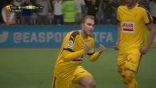 Christian Eriksen scores a goal and celebrates in FIFA 18