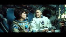Sandra Bullock and George Clooney getting chummy in Gravity