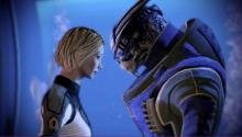 Fem Shepard and an alien character together in Mass Effect 2