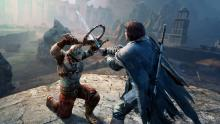Talion fights an enemy forcing him to the ground in Middle Earth: Shadow of Mordor
