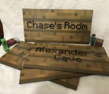 These custom signs are available on Etsy! From user: acmepropcompany.