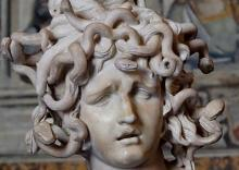 A gorgon, Medusa's owerful stare could turn anyone who gazed upon her into stone.