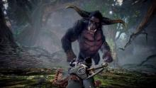 A Rajang stares down a Hunter with a Great Sword.