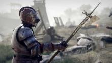 A mercenary wielding a polearm about to fight