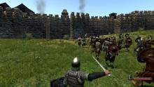 Battle knights right outside the village, or better yet, storm the village in Mount&Blade.