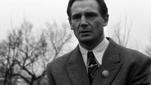 Liam Neeson stands heartbroken at the atrocities he has witnessed.