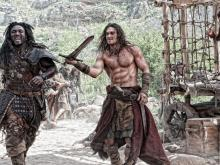 Conan the Barbarian showing off his sword skills.