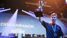 Mr. Savage hoists up the 1st place trophy after winning DreamHack.