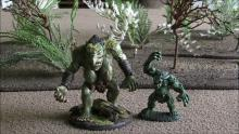 Two ogre minis standing threateningly.