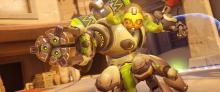 Orisa locates an off screen target while having a barrier protect her backside