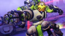 Orisa uses her barrier to protect from enemy fire.