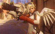 Mercy using her pistol, which she can use to defend herself against enemies when there are no allies around.