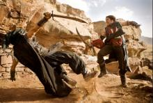 Prince Dastan fights a mysterious assassin.