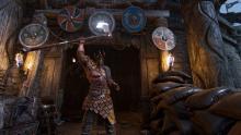 A Raider raises his ax, standing guard