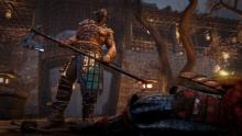 A Raider looks over the dead body of his opponent