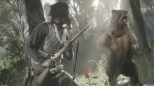 A massive bear rears up as a player approaches.