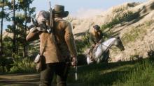A player carries a freshly slain rabbit.