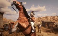 A player rears their horse, showing off as they ride through town.