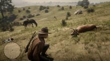 A player approaches a buck carcass, ready to skin it.