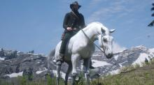 A player ride his White Arabian back into Strawberry after fishing in the mountains.