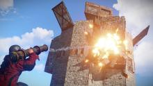 Rocket taking out a wall in a tower base.