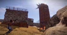 End-game players raid a sheet metal base using rockets.