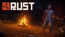 A half-naked player stands next to a campfire at night.